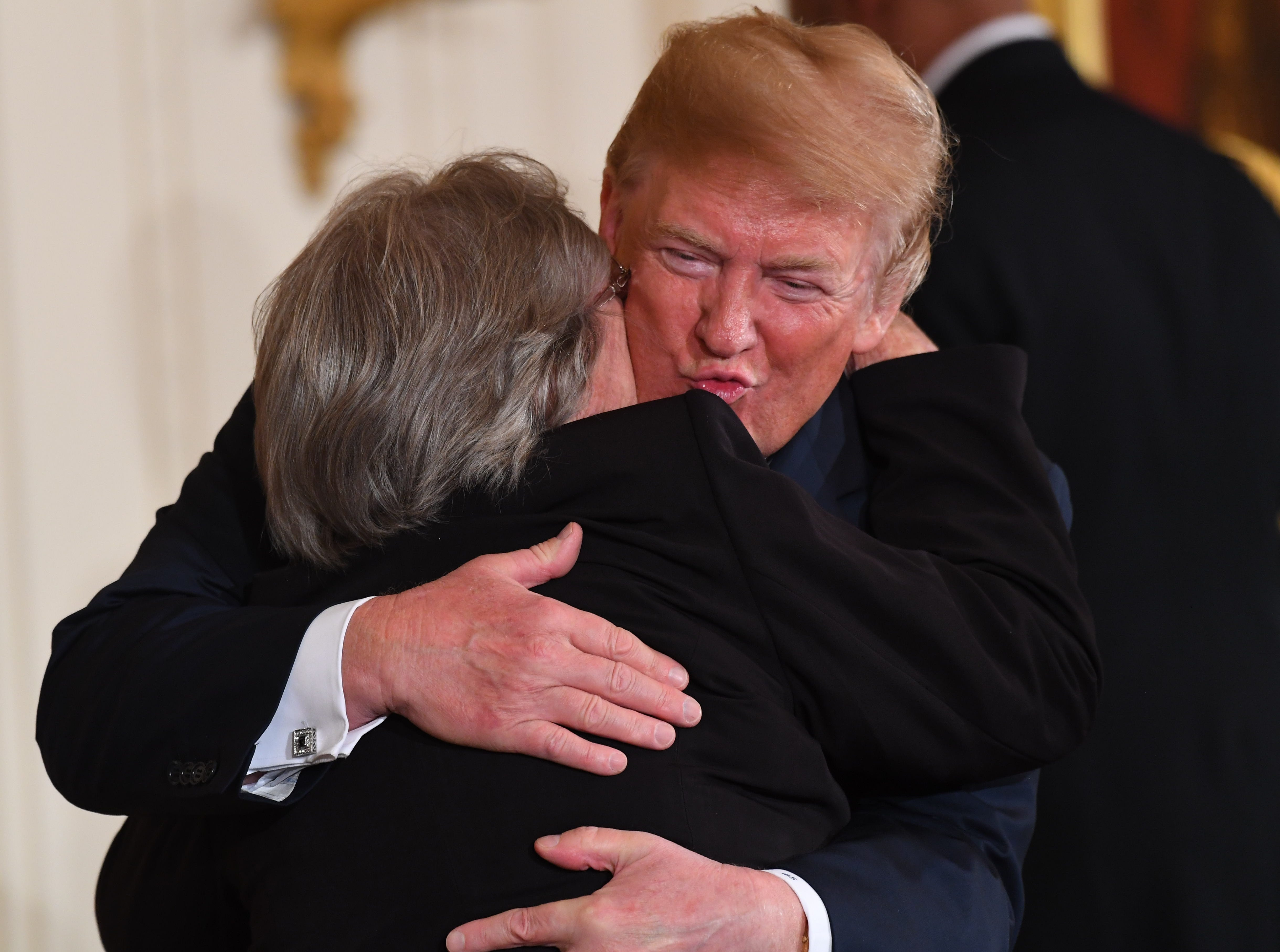 President Donald Trump embraces Pauline Conner the widow of Kentucky soldier First Lt. Garlin M. Conner posthumously honored with the Medal of Honor on Tuesday, June 26, 2018, for his actions in World War II.