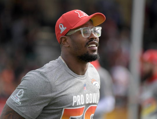 Broncos linebacker Von Miller won't face charges after posing with a bloody hammerhead shark.