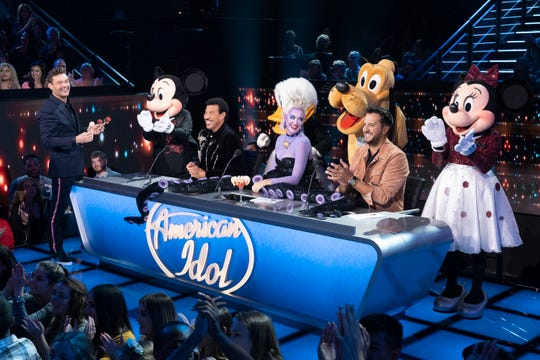 'American Idol' host Ryan Seacrest, left, and judges Lionel Richie, Katy Perry and Luke Bryan were joined by some familiar friends for the ABC singing competition's Disney Night on Sunday.