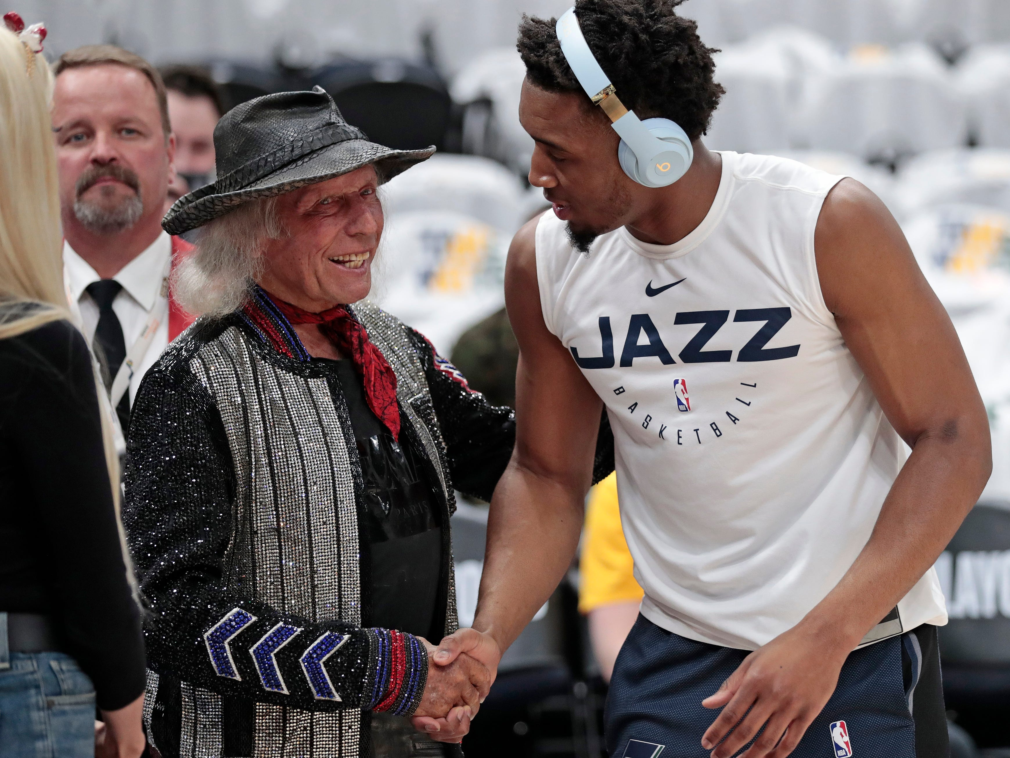 April 22: NBA superfan and millionaire Jimmy Goldstein greets Jazz guard Donovan Mitchell before Game 4 against the Rockets.