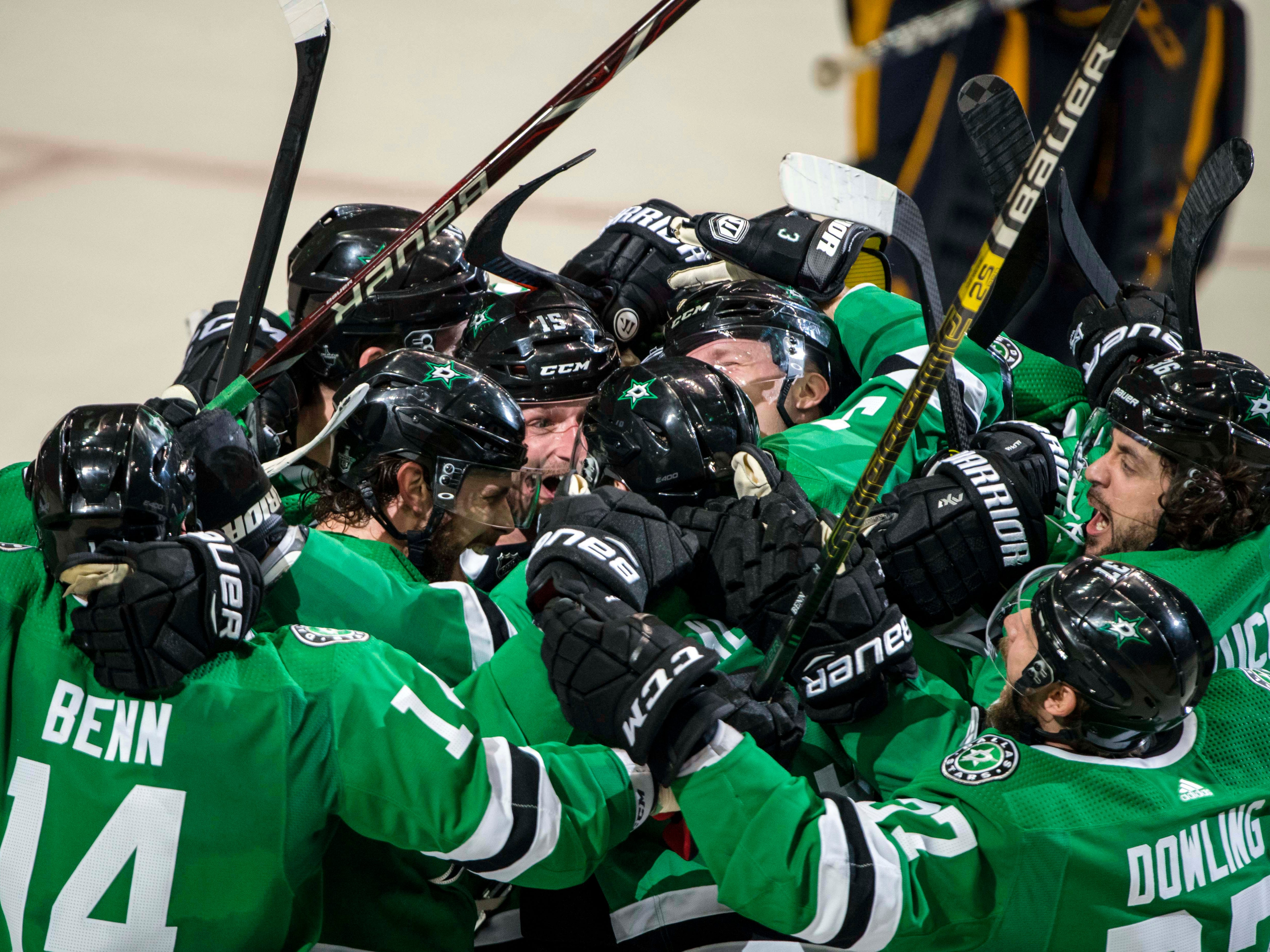 First round: The Stars celebrate after John Klingberg's series-clinching overtime goal in Game 6 against the Predators.