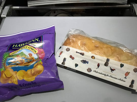 Hawaiian Airlines' light meal includes a sandwich and chips with an island flair.
