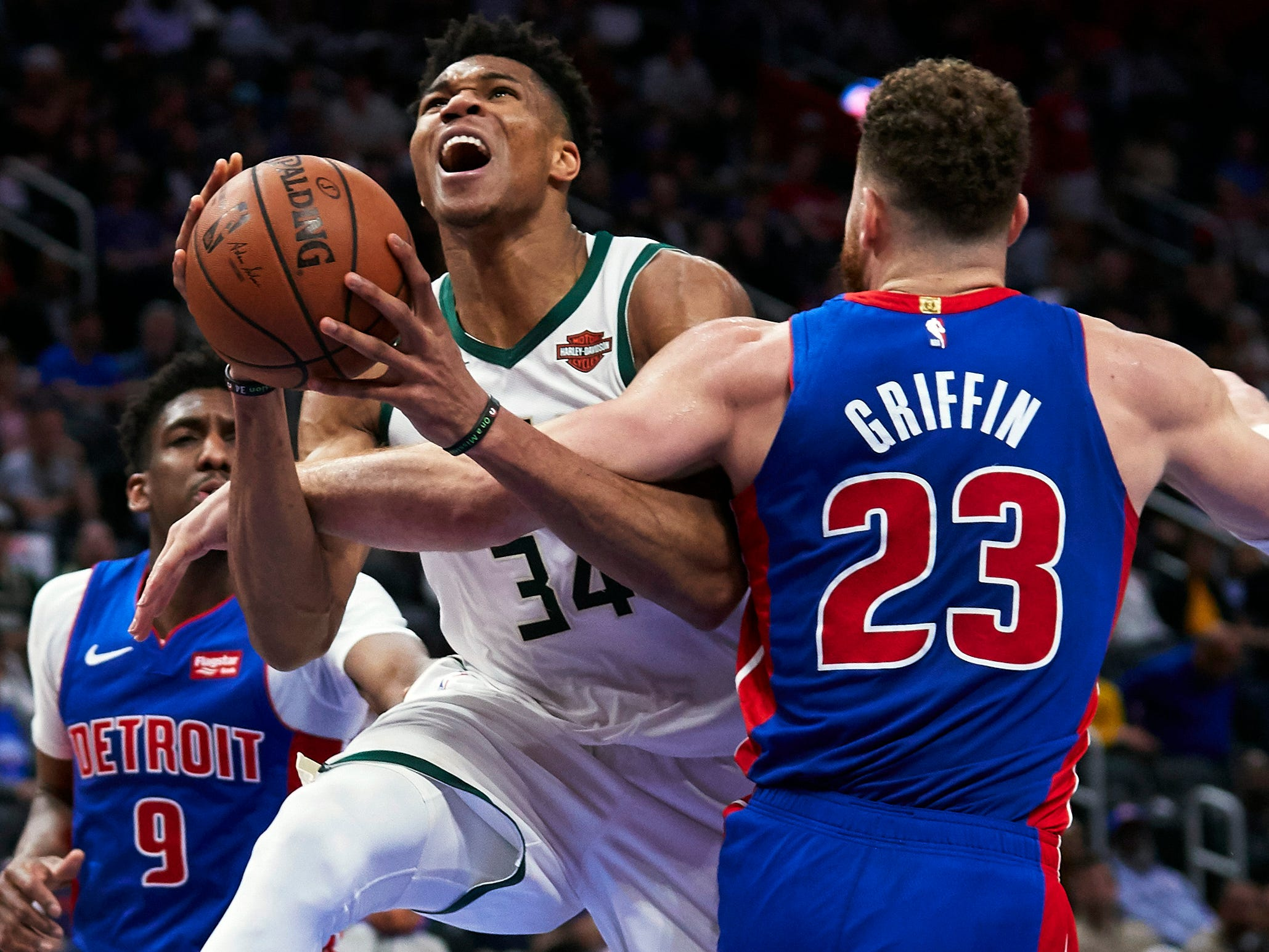 April 22: Bucks forward Giannis Antetokounmpo (34) drives and draws the foul on Pistons defender Blake Griffin (23) during Game 4 in Detroit.