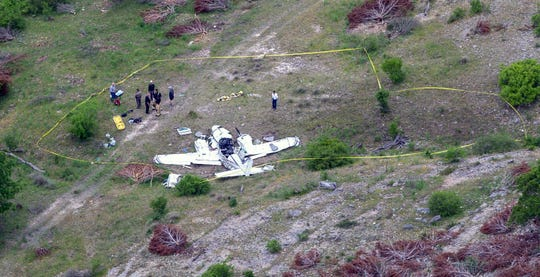 Authorities investigate the crash of a twin-engine Beechcraft BE58 on April 22, 2019, near Kerrville, Texas.