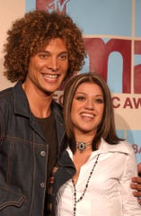 'American Idol' inaugural winner Kelly Clarkson, right, says she would have been fine if runner-up Justin Guarini had triumphed, because then she wouldn't have had to made the disastrous 'Idol' movie, 'From Justin to Kelly.'