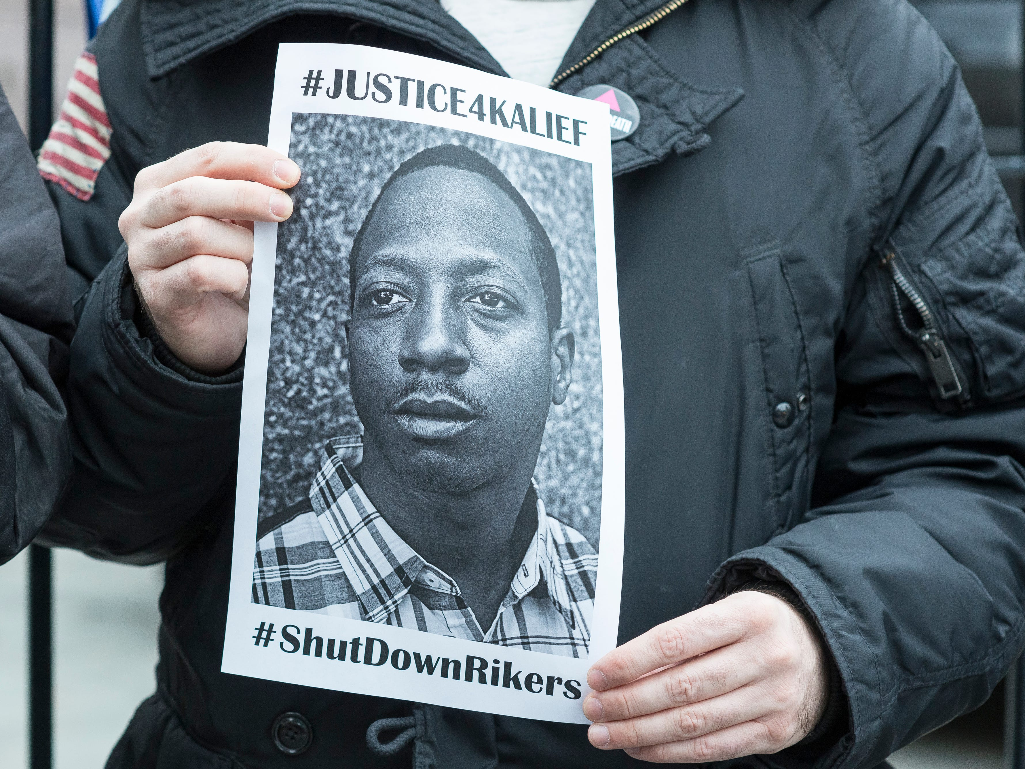 A demonstrator holds an image of Kalief Browder at a protest near City Hall in New York City, NY, USA to demand that it close the long-controversial Rikers Island Corrections facility, on February 23, 2016. (Photo by Albin Lohr-Jones) *** Please Use Credit from Credit Field *** [Via MerlinFTP Drop]