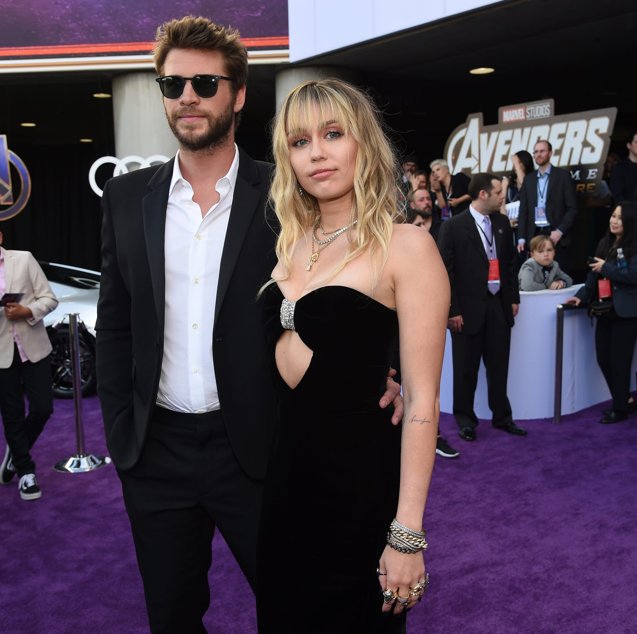 "Liam Hemsworth, left, and Miley Cyrus arrive at the premiere of ""Avengers: Endgame"" at the Los Angeles Convention Center on Monday, April 22, 2019. (Photo by Chris Pizzello/Invision/AP) ORG XMIT: CADC181"
