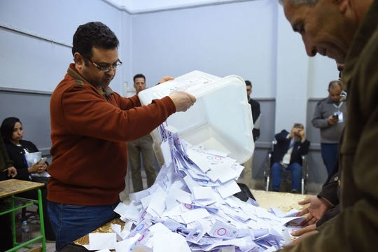 Egyptian officials count the ballots at a polling station in a school of the village of Shebin El Kom in the northern Nile delta province of Menoufia, on April 22, 2019, after the third day of a referendum on constitutional amendments. Egyptians voted for a third and final day Monday on constitutional changes that could keep President Abdel Fattah al-Sisi in power until 2030, amid reports of people actively being encouraged to go the polls.