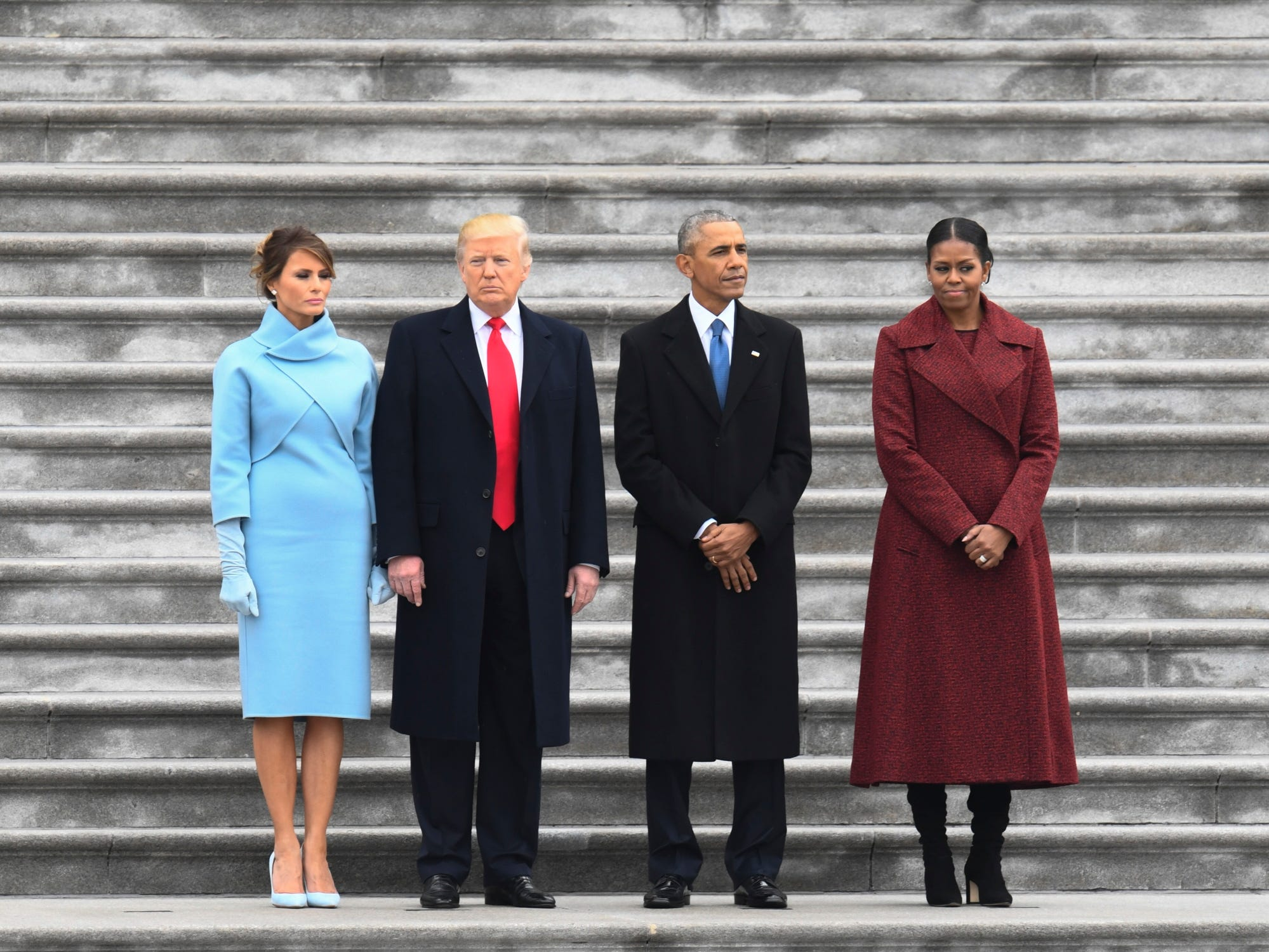 President Donald Trump stands with Melania Trump, former President Barack Obama and Michelle Obama, before the Obama's departs on Marine One after the 2017 Presidential Inauguration at the U.S. Capitol on Jan 20, 2017.