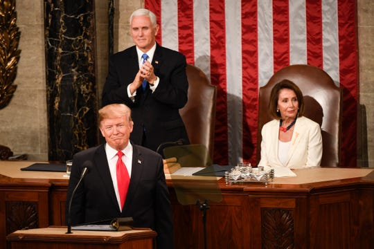 President Donald Trump delivers the State of the Union address on Feb 5, 2019, from the House chamber of the United States Capitol in Washington. Vice President Mike Pence and Speaker of the House Nancy Pelosi (D-Calif.) are behind Trump.