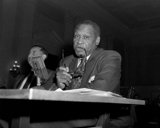 Paul Robeson testifies in Washington on June 12, 1956, before the House Committee on Un-American Activities. The singer also was a lawyer, athlete, scholar and civil-rights activist.