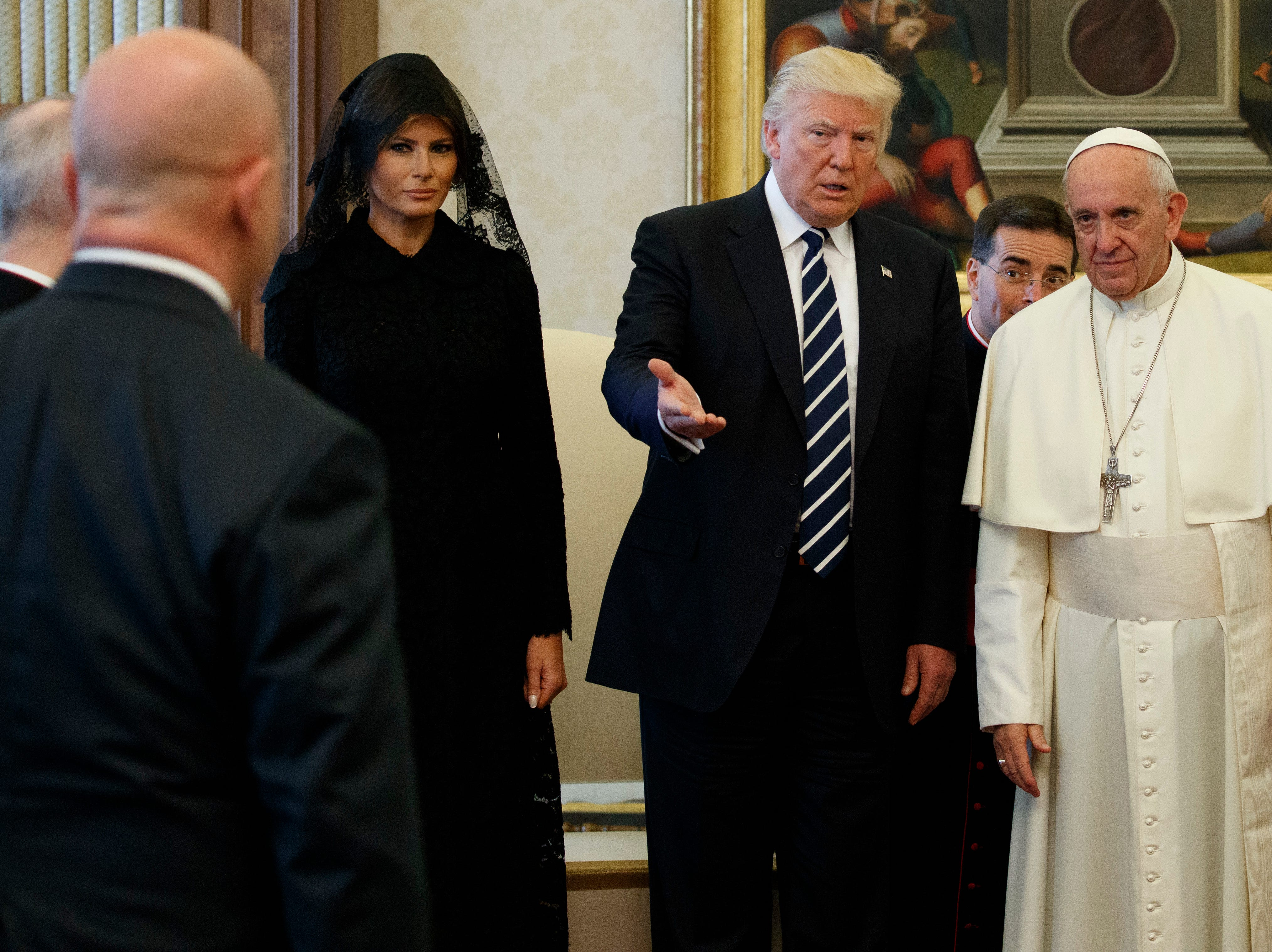 First lady Melania Trump looks on as President Donald Trump introduces National Security Adviser H.R. McMaster to Pope Francis, Wednesday, May 24, 2017, at the Vatican.