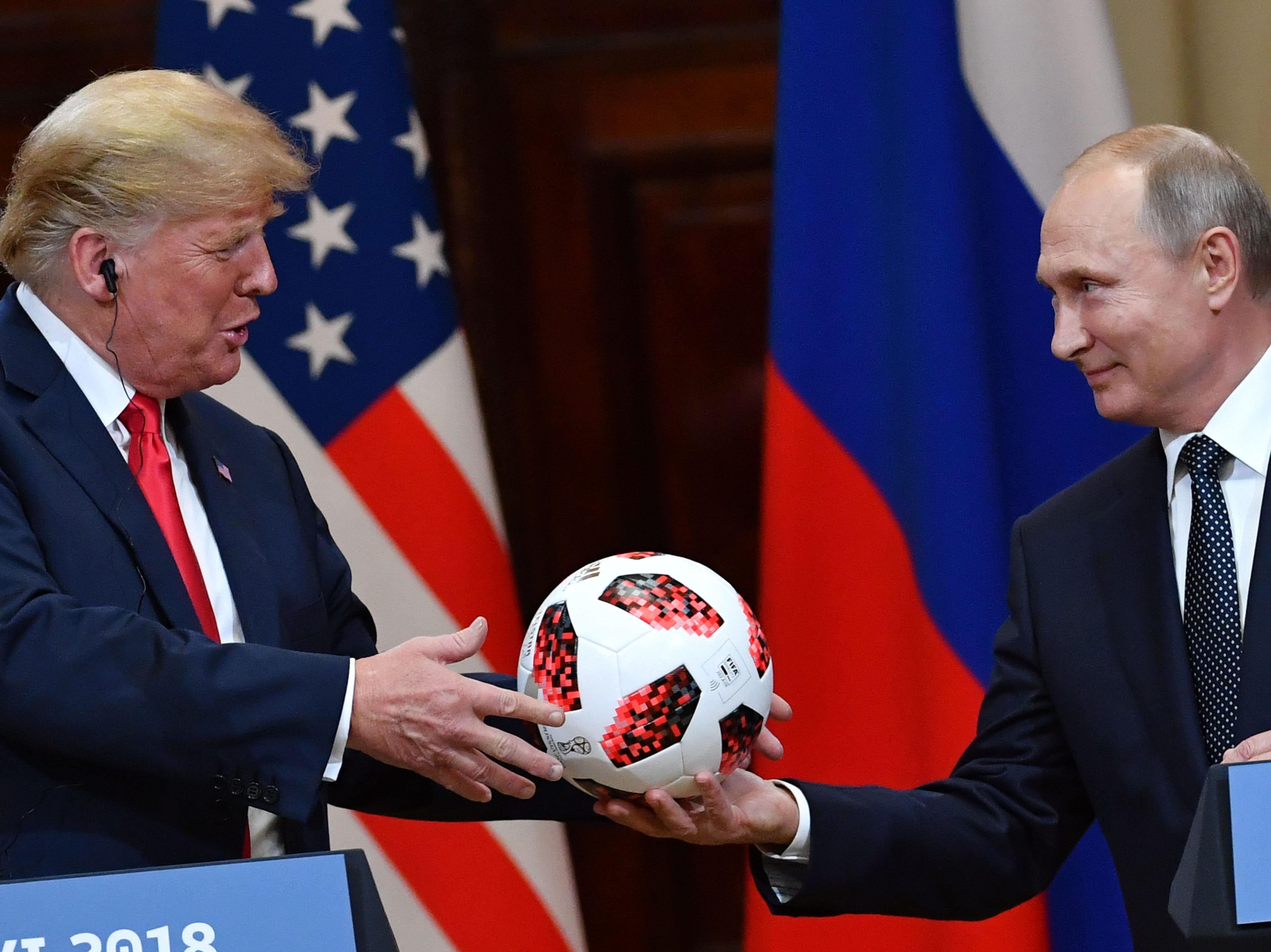 "Russia's President Vladimir Putin offers a ball of the 2018 football World Cup to US President Donald Trump during a joint press conference after a meeting at the Presidential Palace in Helsinki, on July 16, 2018. The US and Russian leaders opened an historic summit in Helsinki, with Donald Trump promising an ""extraordinary relationship"" and Vladimir Putin saying it was high time to thrash out disputes around the world."