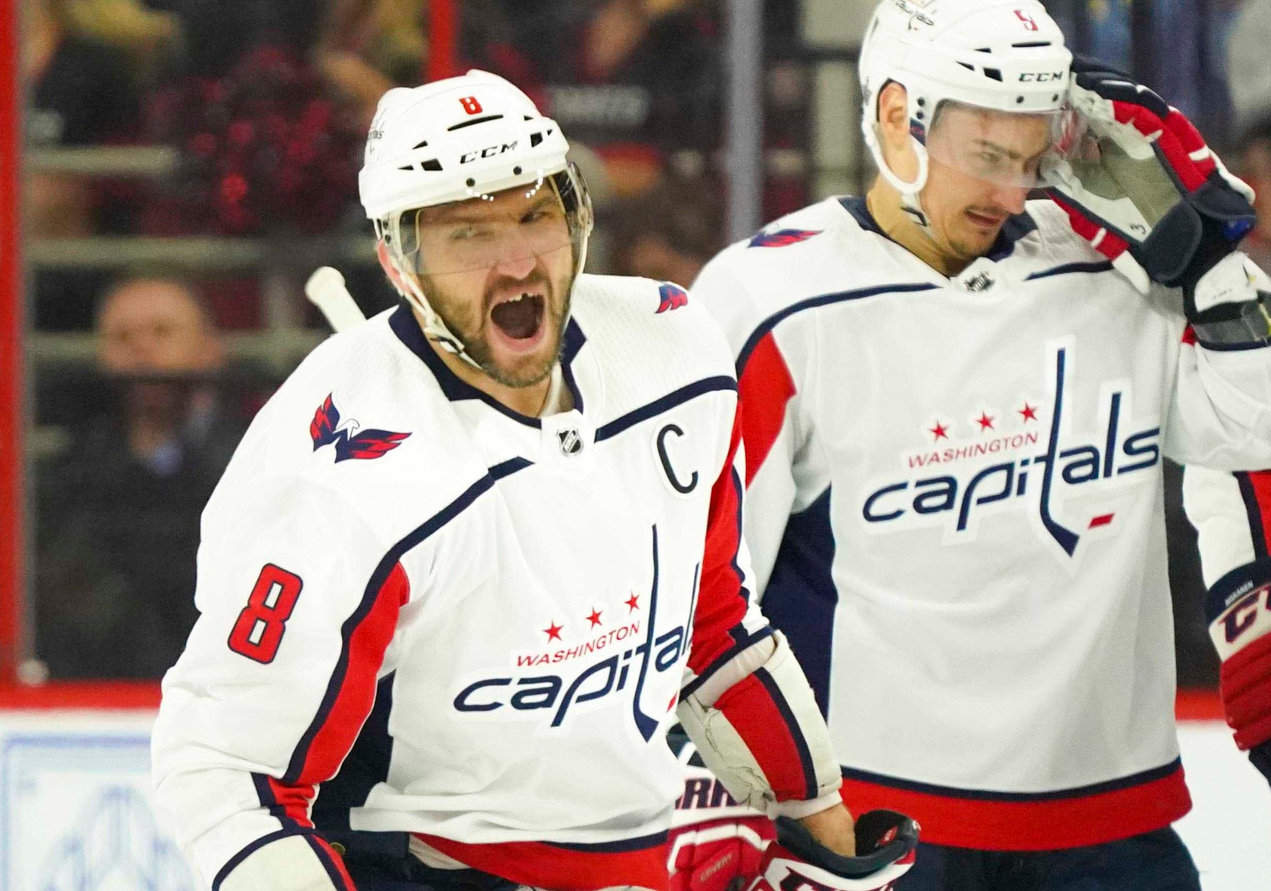First round: Capitals star Alex Ovechkin celebrates his first-period goal against the Hurricanes. But his third-period tying goal was waved off, and Carolina won 5-2 in Game 6.
