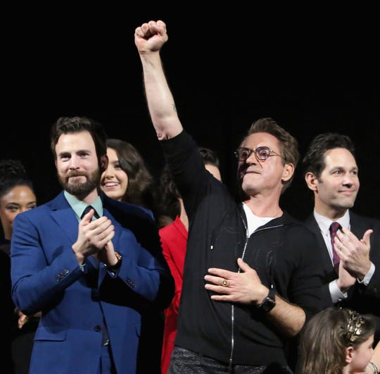 """Robert Downey Jr., middle, doesn't say much at the """"Avengers: Endgame"""" premiere, but he shows his pride with a raised fist. Chris Evans, left, admits that he didn't get through the movie with dry eyes."""