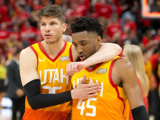 Jazz guard Kyle Korver consoles guard Donovan Mitchell following a Game 3 loss to Houston.