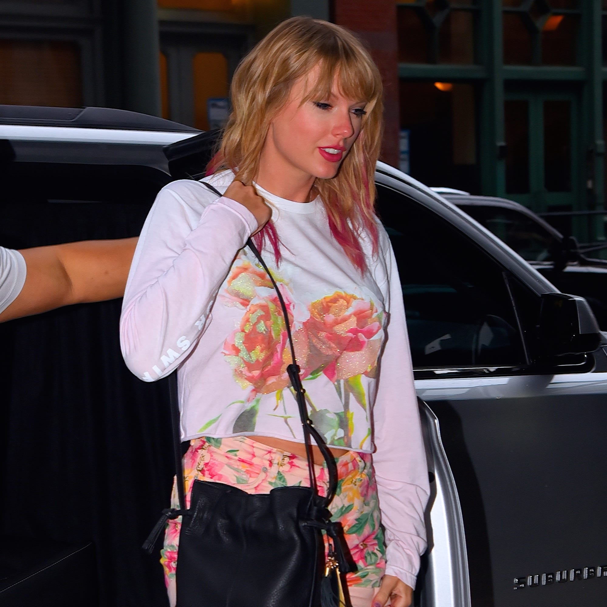 Taylor Swift debuted pink hair – as well as new merch –  while out and about in New York Tuesday.