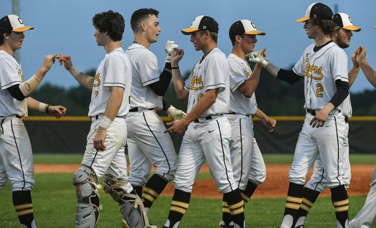 Crescent players congratulate each other after beating Chester 5-4 in the Class AAA Region 1 state playoffs at Crescent High School in Iva Tuesday, April 23, 2019.