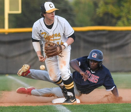 Crescent freshman Caide Linker (14) pitches the ball in after forcing out Chester freshman Jordan Price to get out of the top of the fifth inning of the Class AAA Region 1 state playoffs at Crescent High School in Iva Tuesday, April 23, 2019.