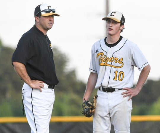 Crescent head coach Blair Carson, left, talks with pitcher Jarrett Oakes (10) during the top of the fifth inning of the Class AAA Region 1 state playoffs at Crescent High School in Iva Tuesday, April 23, 2019. Coach Carson kept Oakes in the game and he threw a complete game. The Tigers won 5-4.
