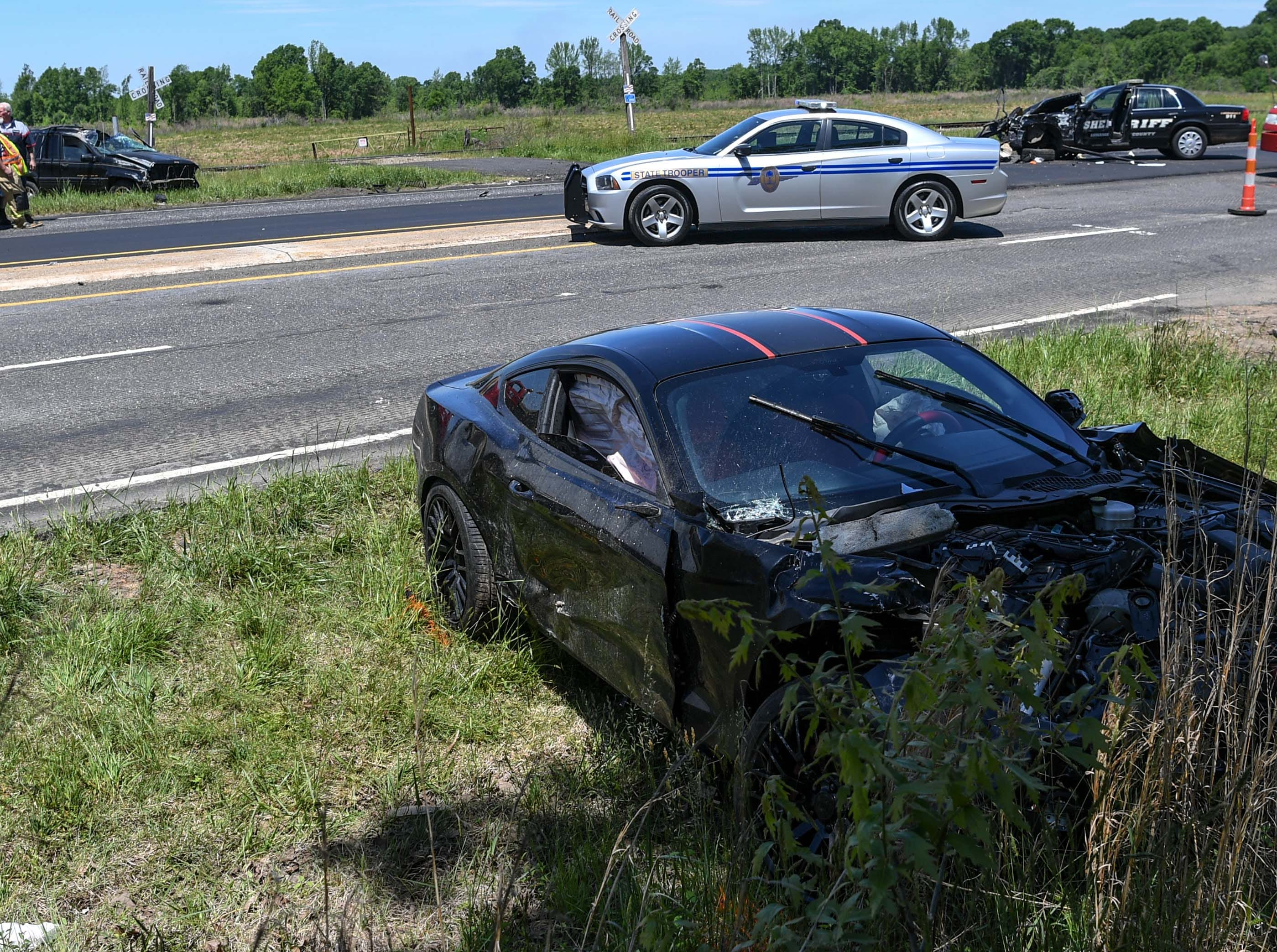 State troopers work the scene of an accident involving two cars and a Anderson County Sheriff Deputy car near West Point Drive on state highway 81 South of Anderson Wednesday.