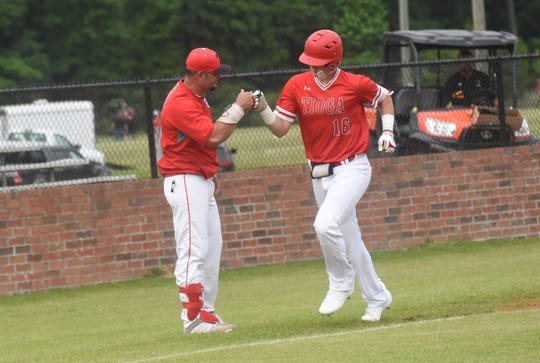 Tioga's Rylon Ganey (16) celebrates with coach Dave Montiel after hitting a home run against Westgate High School Tuesday, April 23, 2019 in the  2019 Allstate Sugar Bowl/LHSAA Baseball State Tournament Class 4A playoff game. Tioga won 10-0.