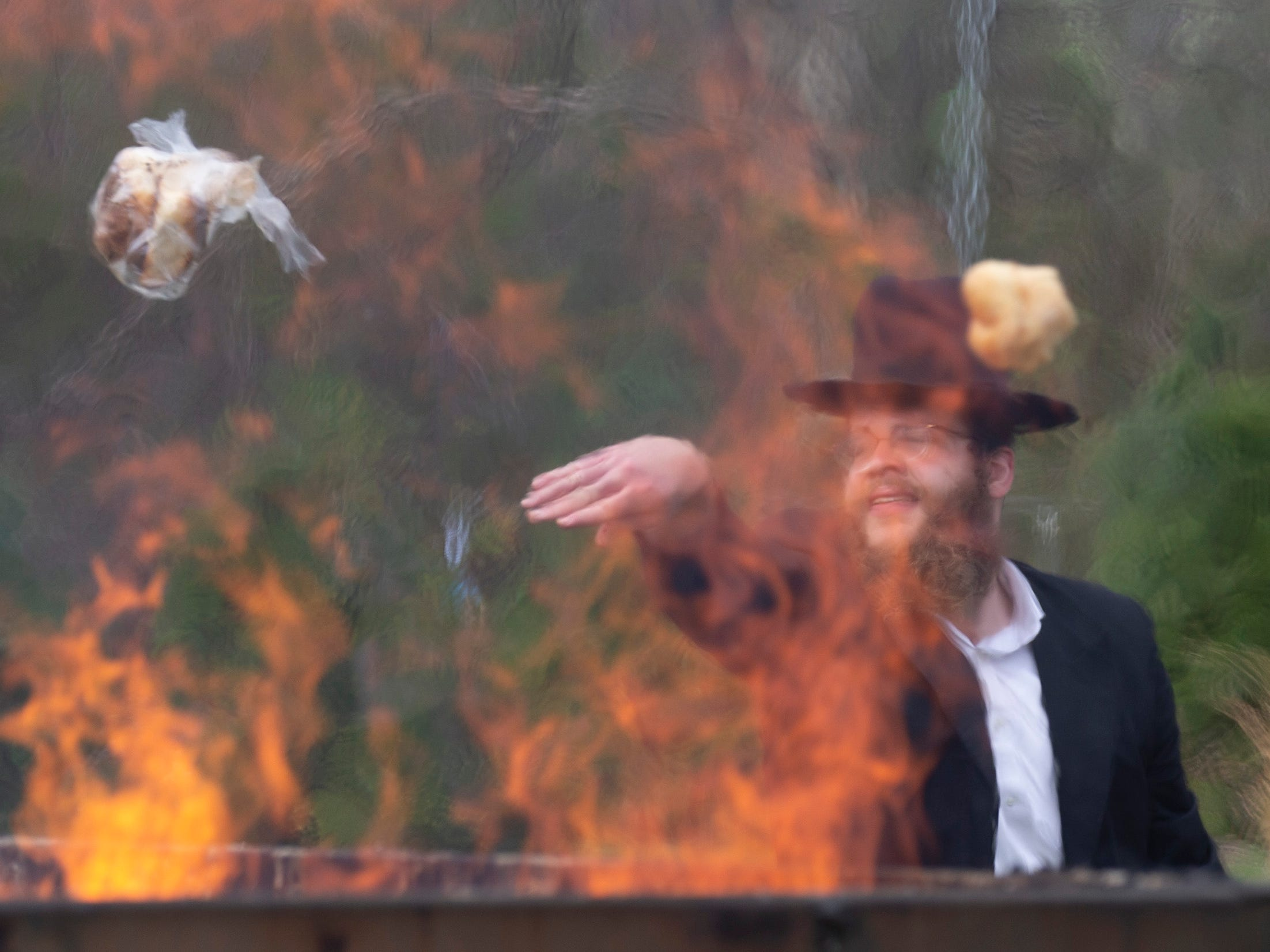 The Orthodox Jewish Community in Lakewood held it's annual burning of all leavened breads before the start of the celebration of passover Friday night. The fire department assisted with the fires to make sure it was done safely. Thousands brought all leaven products for the fires in keeping with the religious commandment that it must be burned.