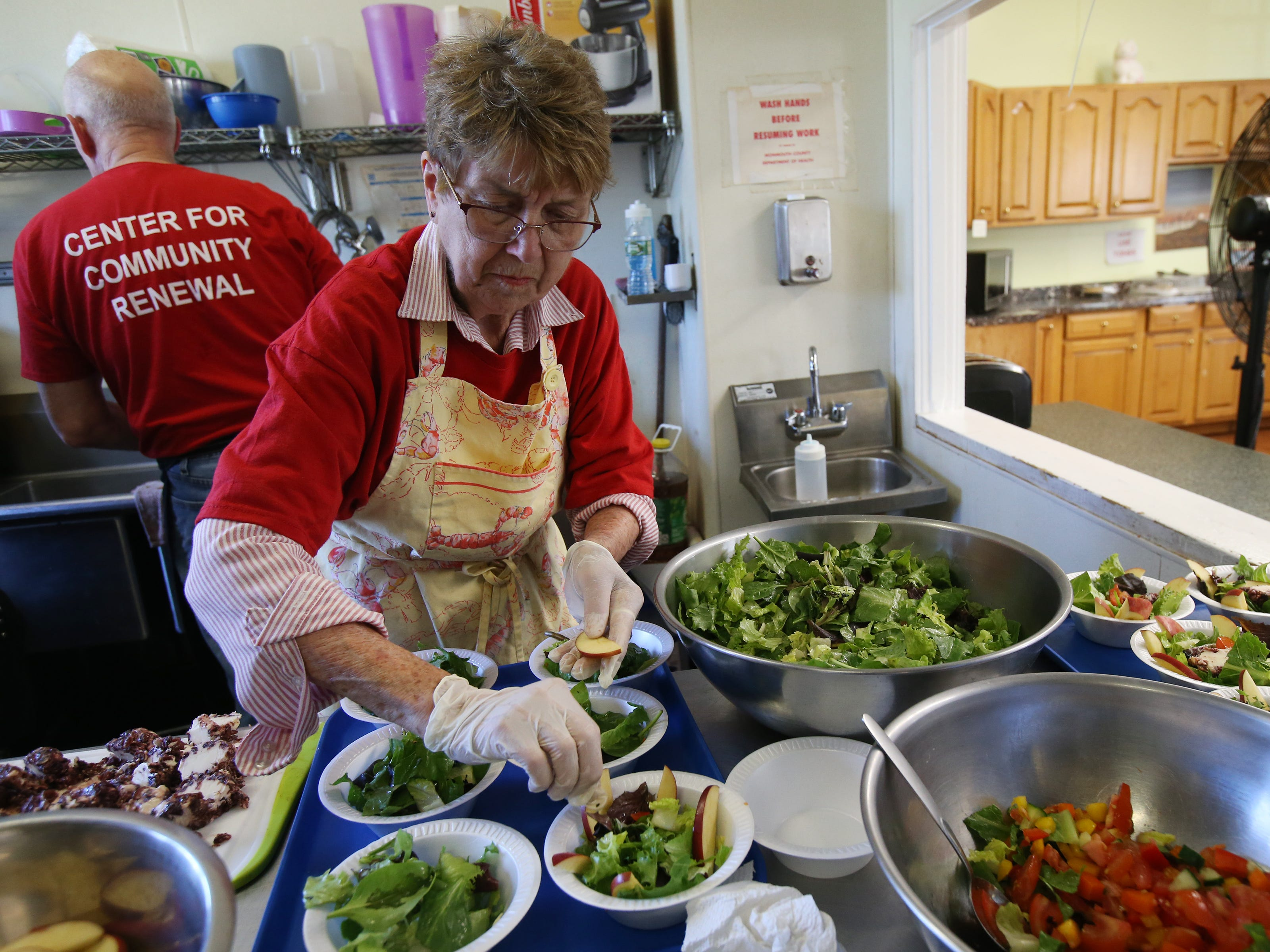 Pam Carlsen of Port Monmouth, a volunteer, prepares salads for at St. Mark's soup kitchen at St. Mark's Episcopal Church in Keansburg, NJ Tuesday, April 23, 2019.
