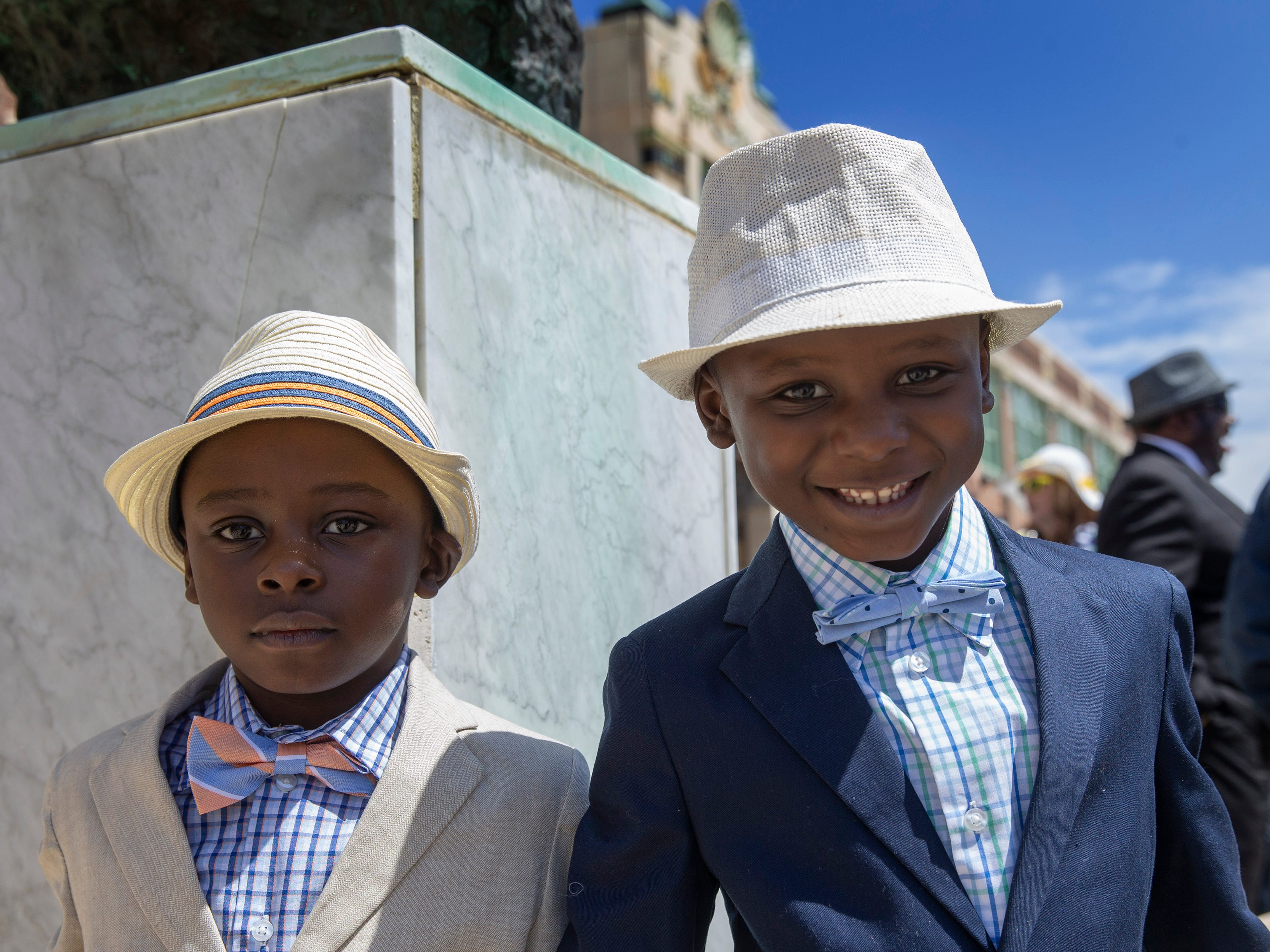 Twins Elijah and Izaiah Hocutt show off their clothes as they wait for the start of the Asbury Park Easter Parade on the boardwalk outside the Paramount Theatre in Asbury Park on April 21, 2019.