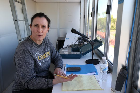Teresa DiMezza, who is on a leave of absence from coaching the St. John Vianney girls lacrosse team, due to having a stroke late last year, watches and keeps score in the box during a game against Neptune at St. John Vianney High School in Holmdel, NJ Wednesday, April 24, 2019.