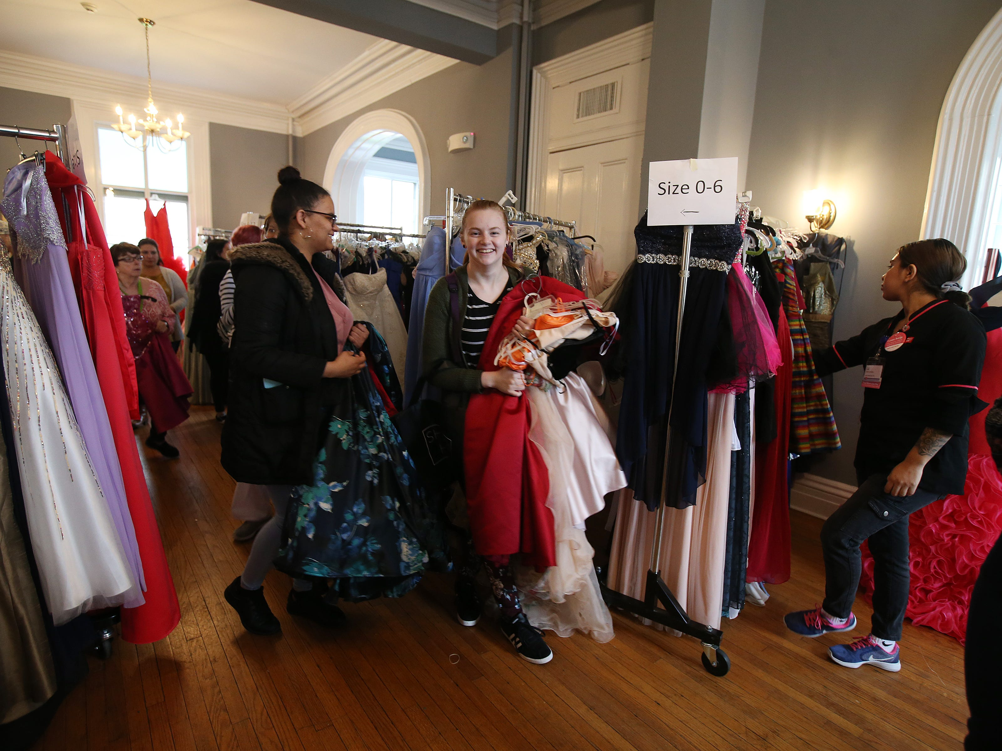 Abril Mendoza, 17, of Manahawkin and Emily Maldonado, 18, of Manahawkin search for the perfect prom dress during the Lunch Break's 4th Annual Prom Giveaway Event at the Woman's Club of Red Bank in Red Bank, NJ Monday, April 22, 2019.