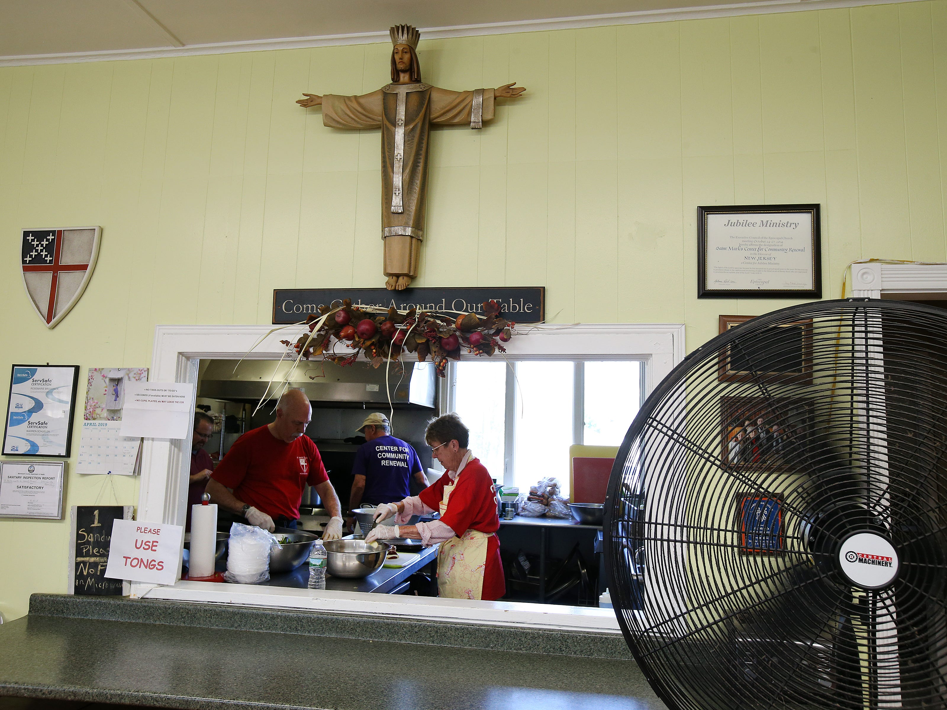 (center) Warren Schueler, a retired culinary institute instructor, prepares lunch with (left) Gary Hamilton of Holmdel and (right) Pam Carlsen of Port Monmouth at St. Mark's soup kitchen at St. Mark's Episcopal Church in Keansburg, NJ Tuesday, April 23, 2019.