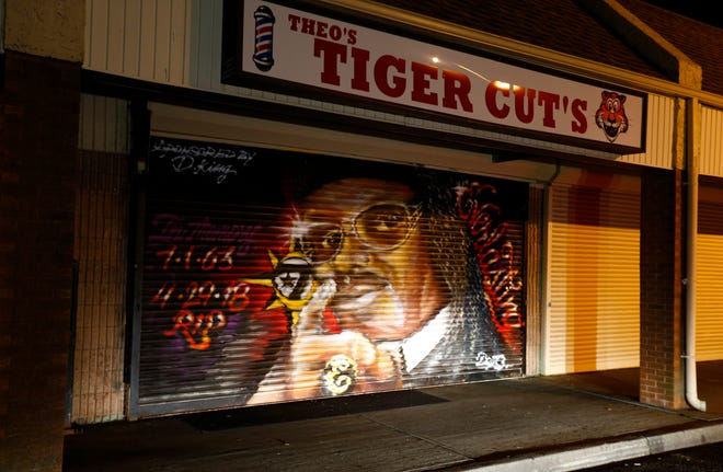 "A mural of Earl ˜Everlasting"" Sanders fills the steel door outside the barber shop where he worked on Memorial Drive in Asbury Park early Wednesday, April 24, 2019."