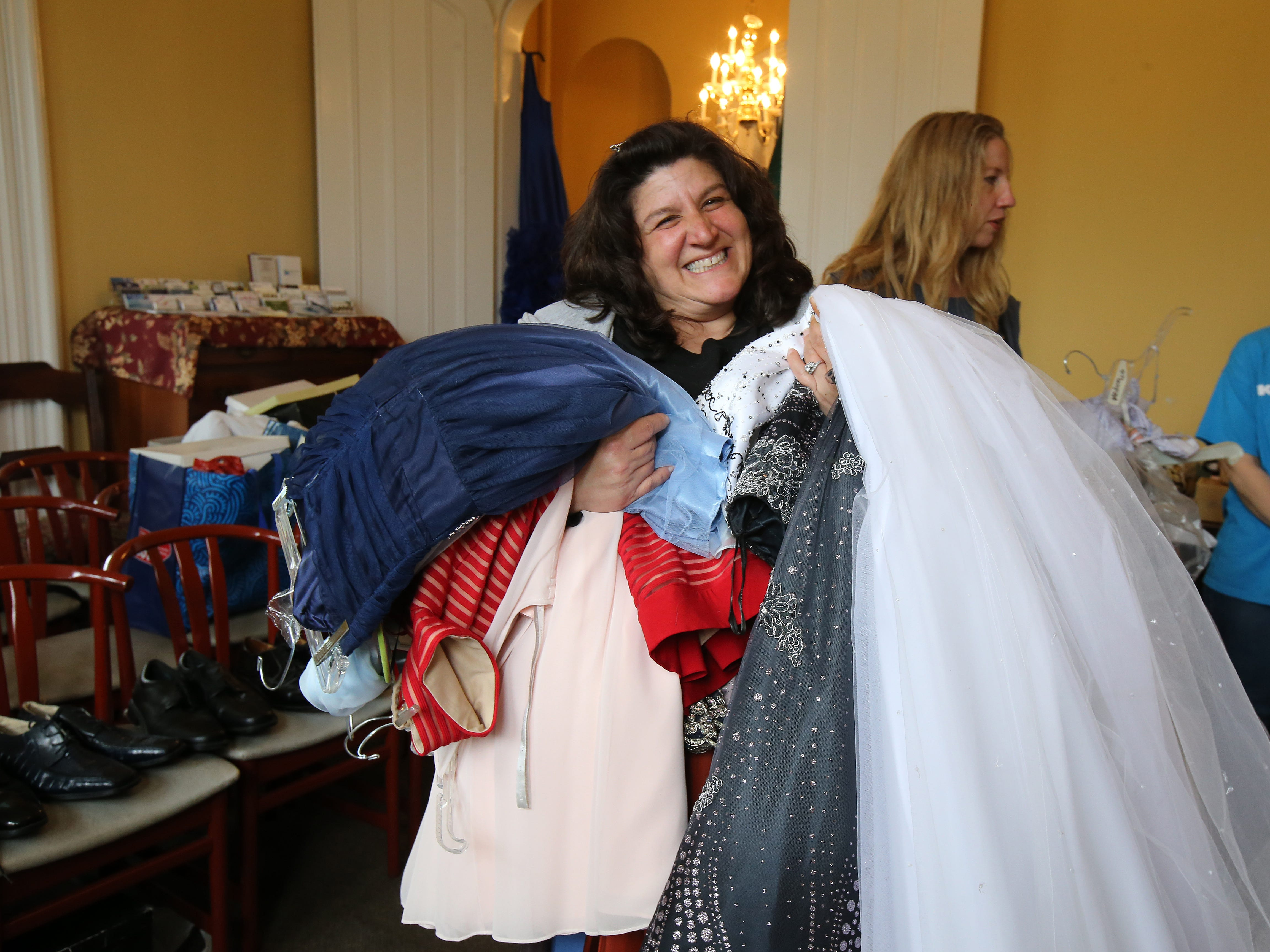 Marie Griffin of Freehold Boro holds her 14-year-old daughter's prom dress picks during Lunch Break's 4th Annual Prom Giveaway Event at the Woman's Club of Red Bank in Red Bank, NJ Monday, April 22, 2019.