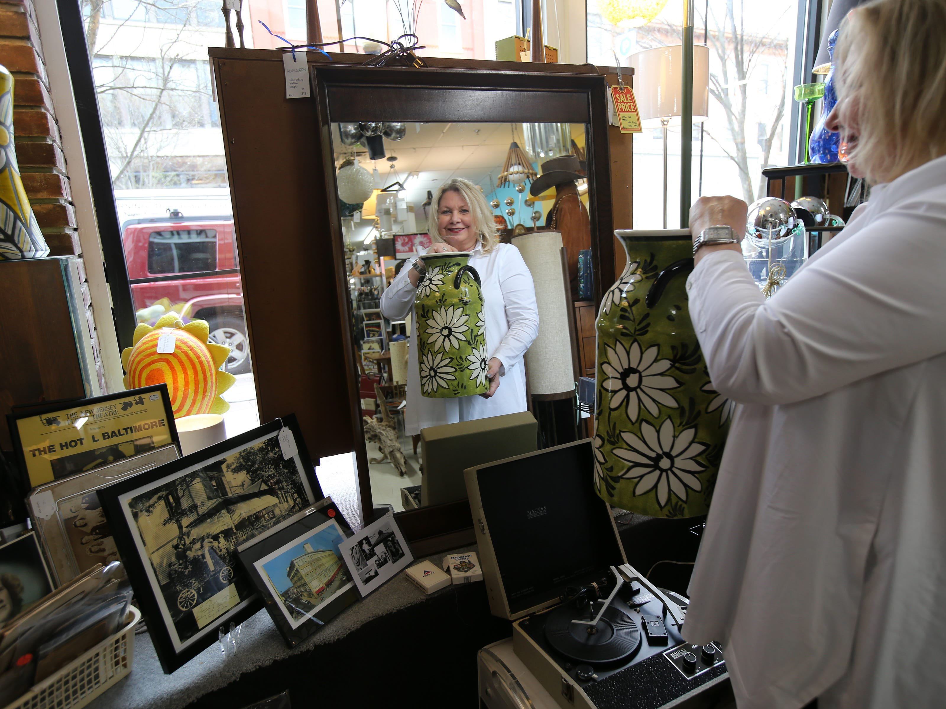 Roni Goldstein, director, talks about some of her favorite items at Antique Emporium of Asbury Park in Asbury Park, NJ Thursday, April 18, 2019.