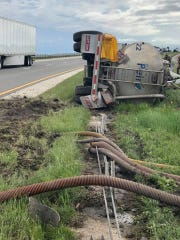 A fuel tanker rolled over on Interstate 20 on Tuesday, killing a passenger in the vehicle.