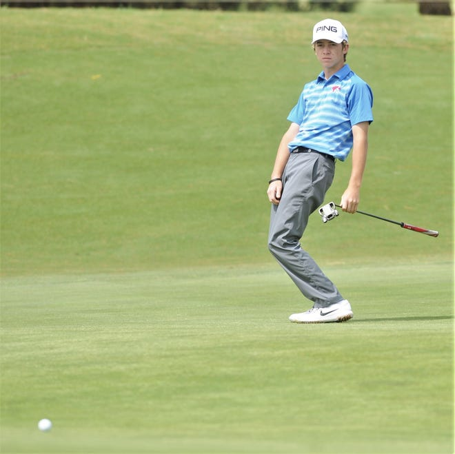 Cooper freshman Karson Grigsby reacts to his putt on hole No. 16 during the first round of the Region I-5A boys golf tournament Wednesday, April 24, 2019, at Texas Tech's The Rawls Course in Lubbock.