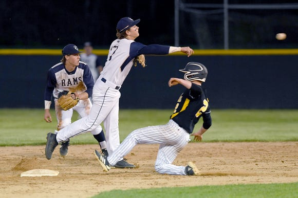 Roberson's Luke Wood throws the ball over Tuscola's Scout Schulhofer as he attempts to slide into second base for a double play during their game at Roberson High School on April 23, 2019.