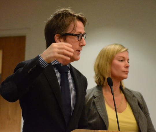 Shawn Smith argues to the judge while assistant prosecutor Karen Pawloski listens.