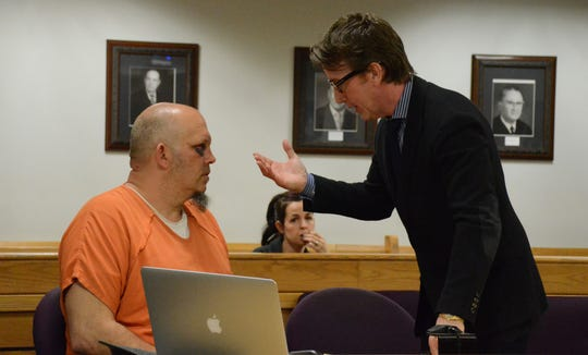 Shawn Smith speaks with his client, Christopher Pratt at the hearing.