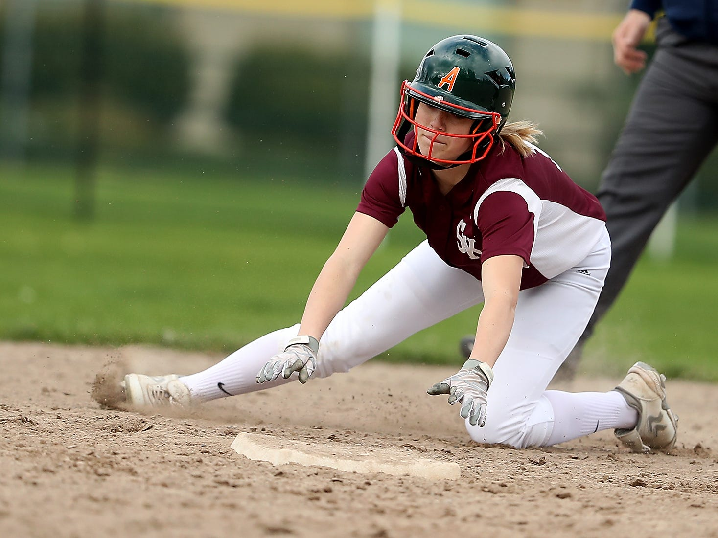 South Kitsap's Marisol Bergstrom steals second as a throw goes awry at Linder Field in Silverdale on Tuesday, April 23, 2019.