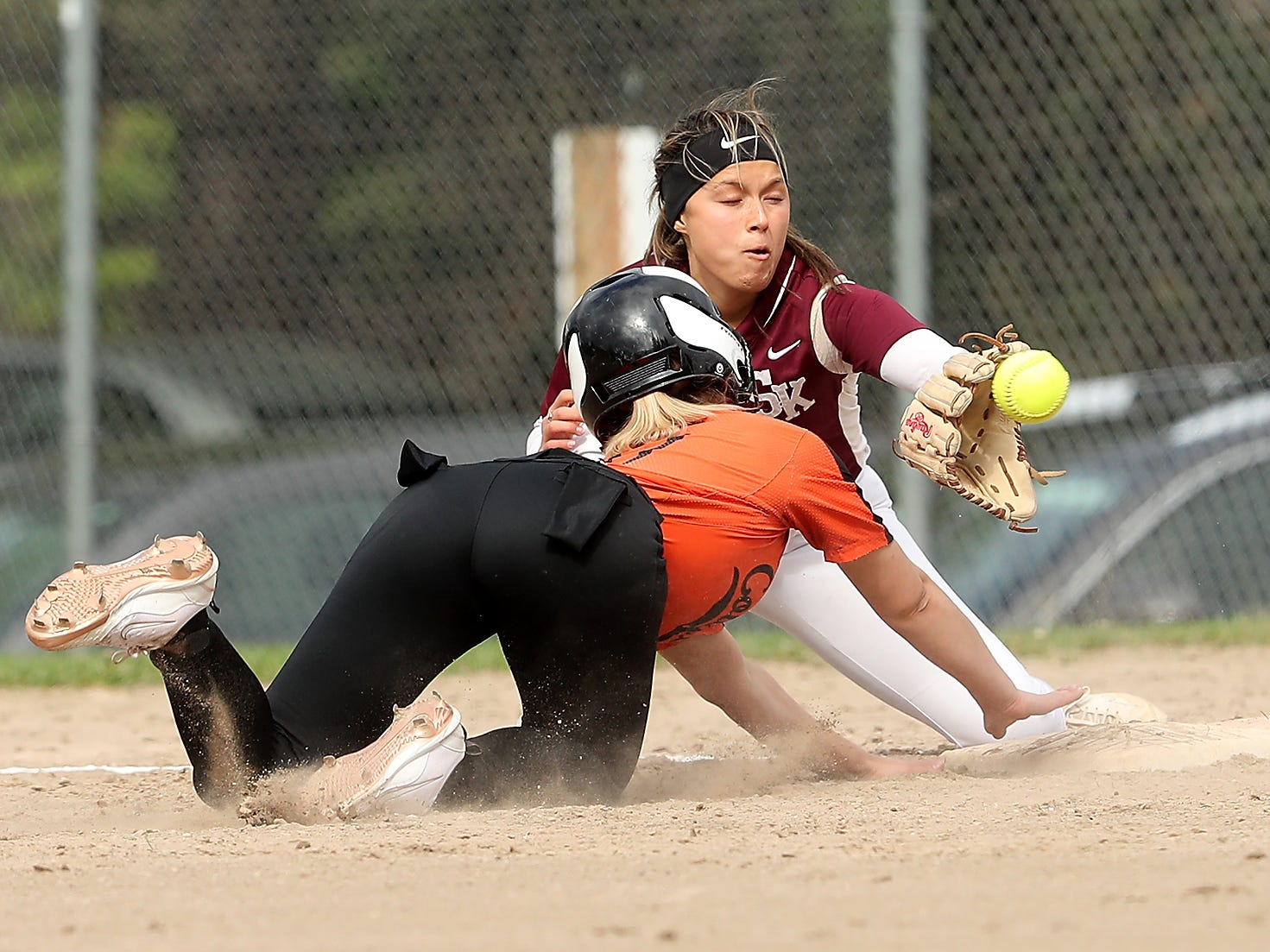 Central Kitsap's Gabby Story collides with South Kitsap's Jordynn Lawrence as she dives back to first at Linder Field in Silverdale on Tuesday, April 23, 2019. Story was safe on the play.