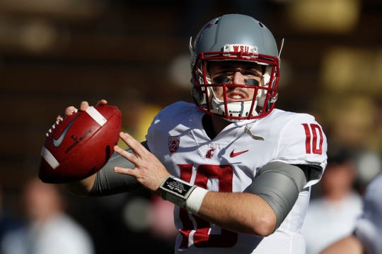 FILE - In this Saturday, Nov. 10, 2018, file photo, Washington State quarterback Trey Tinsley warms up before the first half of an NCAA college football game in Boulder, Colo. Washington State has a spirited quarterback competition involving a large group of would-be starters, including seniors Anthony Gordon and Tinsley, Cammon Cooper, graduate transfer Gage Gubrud and sophomore John Bledsoe.