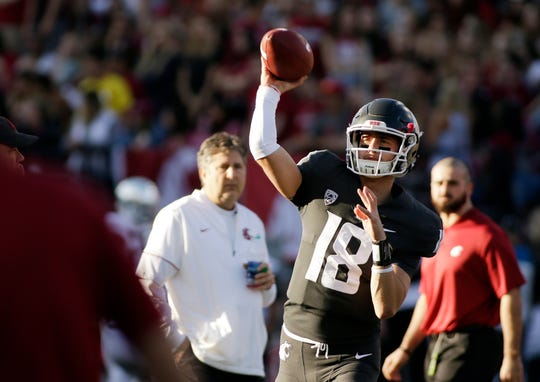 FILE - In this Saturday, Oct. 20, 2018, file photo, Washington State quarterback Anthony Gordon (18) throws a pass while warming up before an NCAA college football game against Oregon in Pullman, Wash. Washington State has a spirited quarterback competition involving a large group of would-be starters, including seniors Gordon and Trey Tinsley, Cammon Cooper, graduate transfer Gage Gubrud and sophomore John Bledsoe.