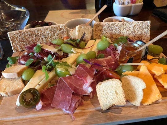 The Wine Cellar features artisan cheese boards.