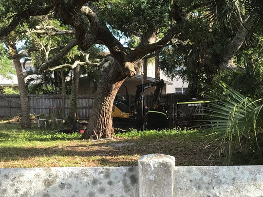 Brevard County sheriff's deputies were digging through the backyard of a Cocoa Beach home.