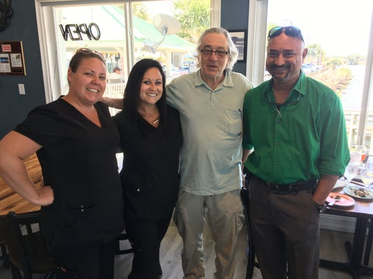 Surprise guest! Oscar winner Robert De Niro had lunch at Pier 220 in Titusville. He's shown with Jessica Burroughs, Dr. Sachin Shenoy, and Danielle Van Wart.
