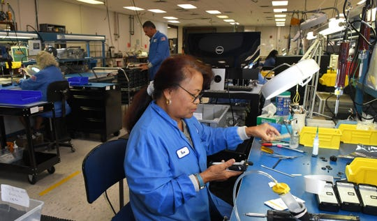 Noo Veight, an operations technician, works on the production line at BK Technologies Inc. in West Melbourne, which manufactures digital communications products, including two-way radios for first responders, public safety and the military. Its products are distributed worldwide.