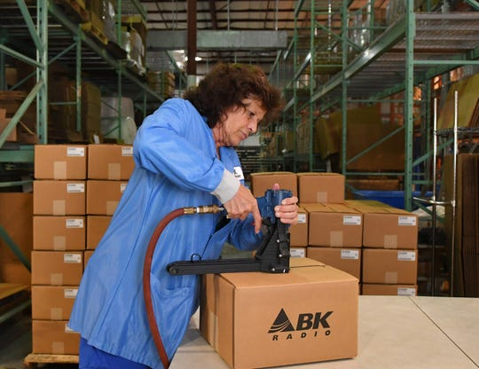 Shipping lead Paula DiSanto prepares products for shipment at BK Technologies Inc.'s facility in West Melbourne.