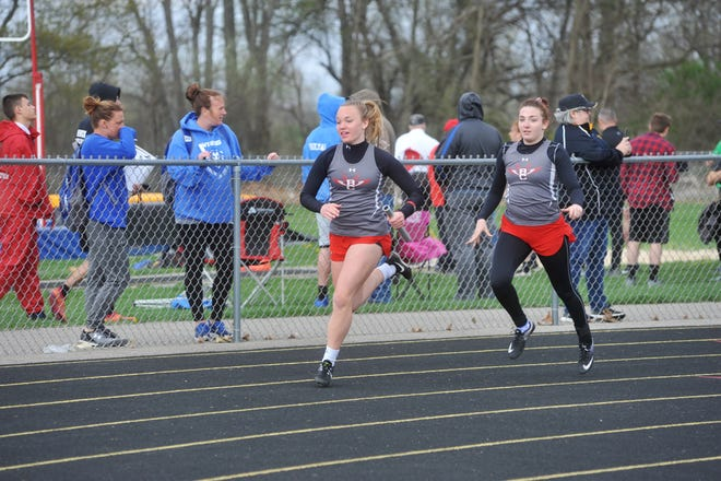Zoie Lewis (right) was part of three regional qualifying relay teams as a Buckette and holds the school record in the 400M dash.